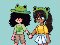 Two girlfriends matching their frog hats